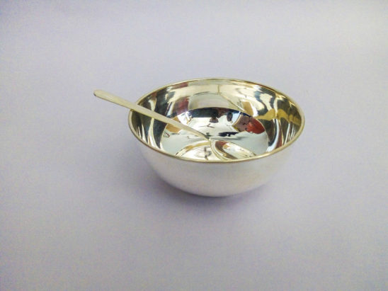 silver cup and spoon