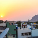 sunset view seen in city with buildings background
