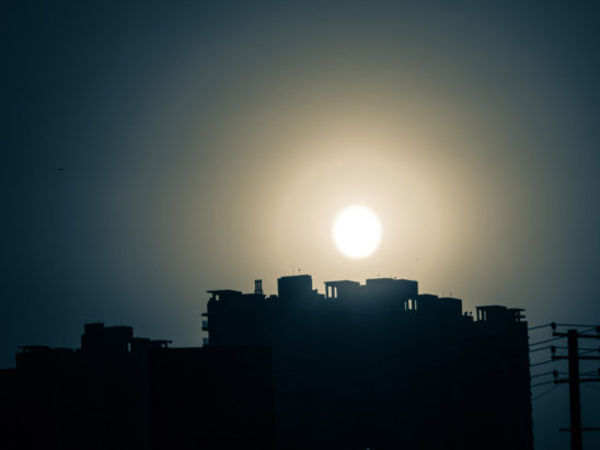 Sun on top of apartments