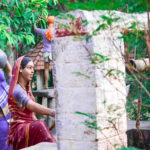 village women bringing water from well