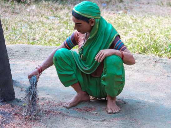 village women cleaning raagi