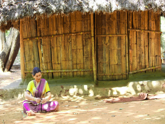 village women in front hut