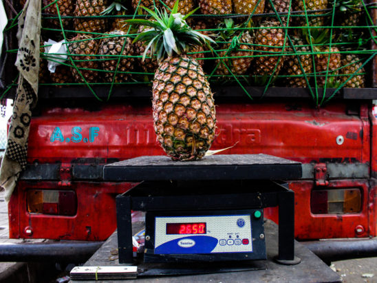 Pineapple on weighing scale