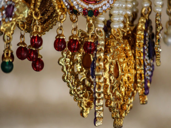 Golden dollar chain with white pearl