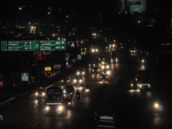 Vehicle lights during night on highway