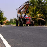 Tractor with lador on road