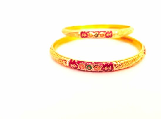 golden bangles under light