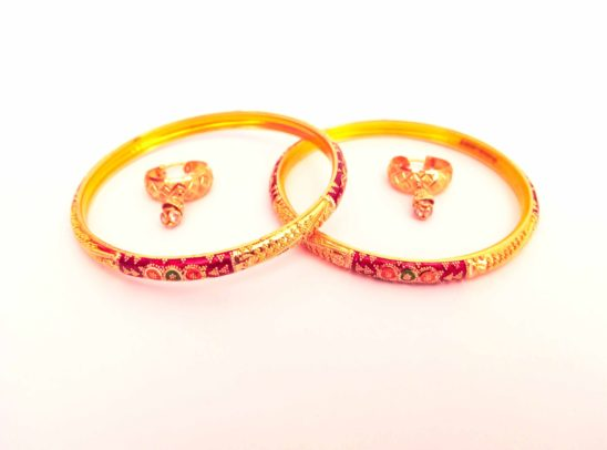 women bangles and ear rings