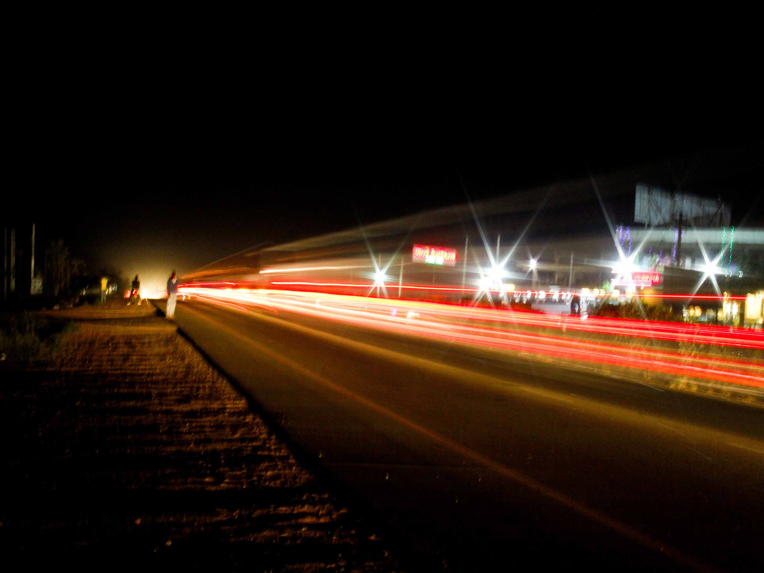 Vehicle headlights glowing on highway during nights