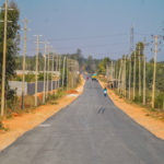 Indian Asphalt straight road with electric poles