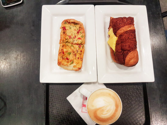 cappuccino with garlic bread and sandwich