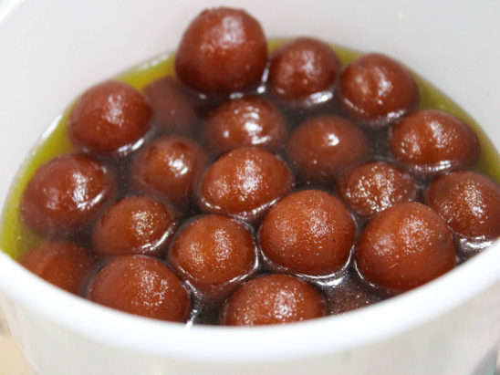 gulab jamoons dipped in sugar syrup