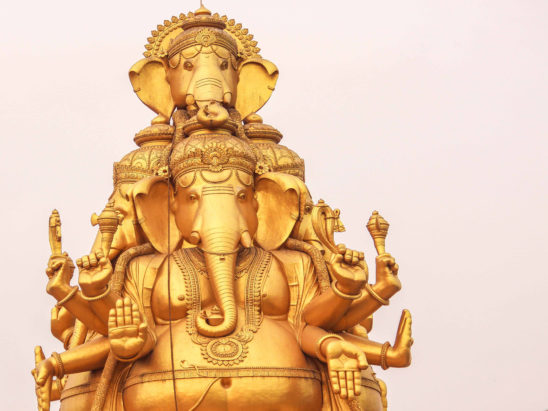 lord ganesh statue in golden color
