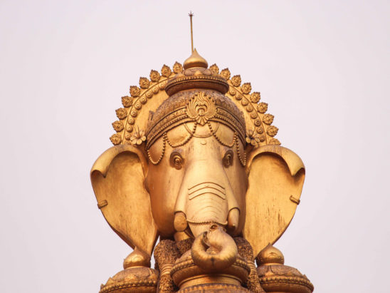 lord ganesh statute in golden color