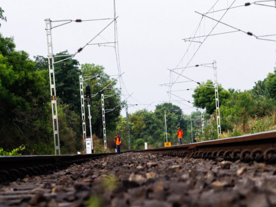 railway workers checking railway track