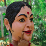 snake charmer lady face side view