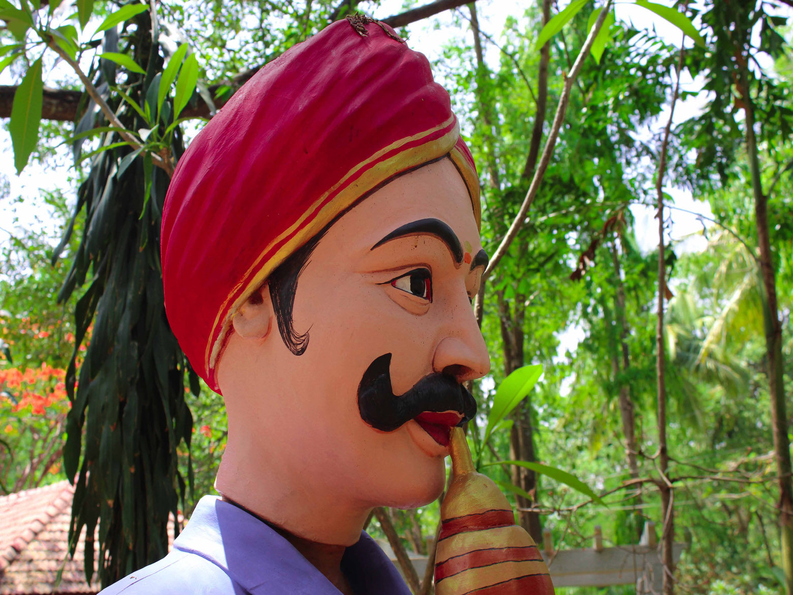 snake charmer with pungi side view