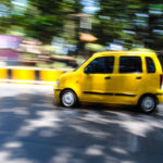 Yellow Wagon R Car on Road