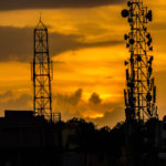 Mobile towers in sunset