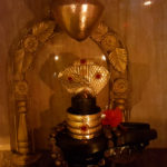 Shiv ling with golden snake